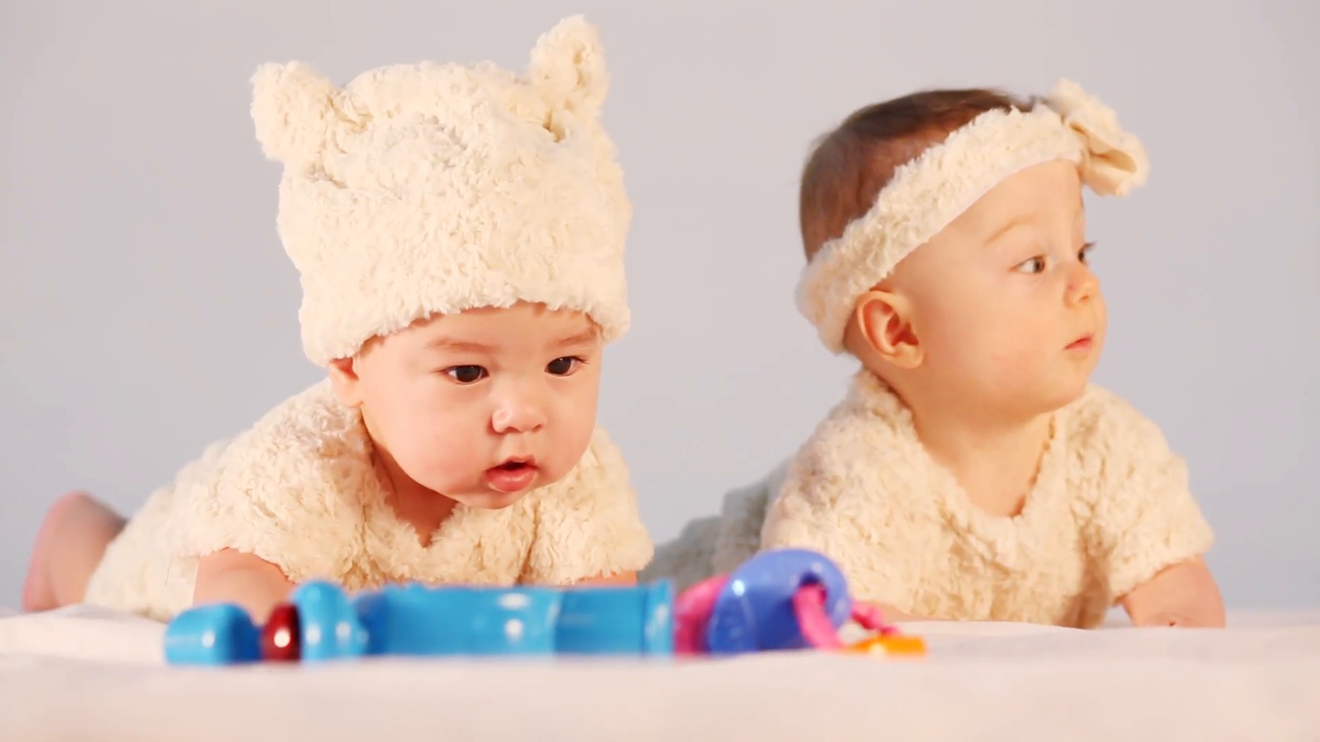 Two Babies Dressed In Fur Costumes Lying On A Blanket In The Studio Stock Video Footage   Videoblocks - Two Babies, Transparent background PNG HD thumbnail