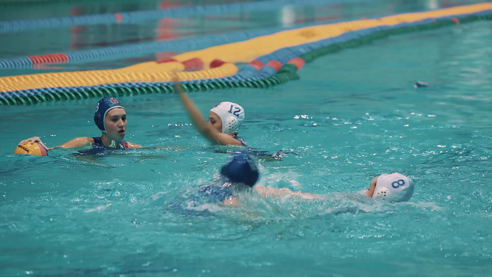 Water Polo Png Hd - Female Water Polo Player In White Cap Blocking Opponent In Blue Cap With Ball In Swimming Pool During Tense Game Stock Video Footage   Videoblocks, Transparent background PNG HD thumbnail